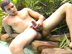 Twink jerk off by the pool side and climb in a tree to cum