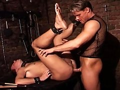 Guy in leather uses a bottom male to satisfy his impulses