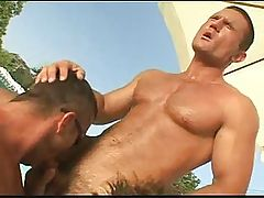 Handsome gay hunk sucks meaty thick cocks near the poolside